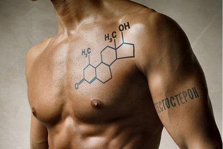 Мускулистый мужчина с формулой тестостерона